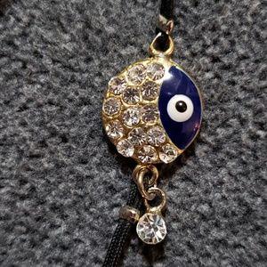 Cubic Zirconia Gold Tone Blue Eye Charm Bracelet